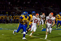 #54 and 62 cornering the quarterback Tyrell Adams #12